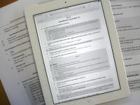 A Bill on an iPad and printed